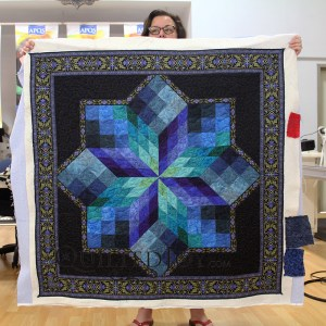 Pam custom quilted this Stained Glass Star wall hanging at Quilted Joy