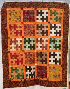 Susan's quilt is a tessellating design made entirely of batiks. I quilted it with a neutral thread that blends well and a meandering design. Fun!