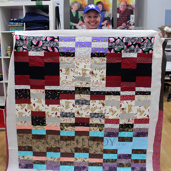 Kim made this playful Staggered Strips quilt to practice both her piecing skills and her free motion quilting!