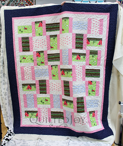 Nancy's modified rail fence quilt with fun farm fabrics