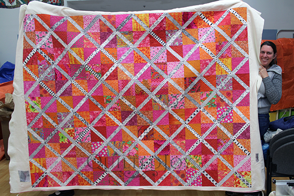 Lattice of Love quilt, pieced by Rena and machine quilted at Quilted Joy