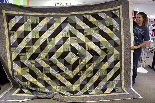 Angie used the APQS George at Quilted Joy to quilt this gorgeous quilt!