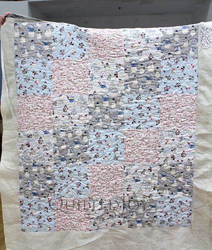 Nancy quilted this sweet and simple quilt with adorable snowman fabrics!