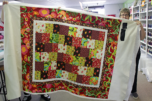 Margie's floral quilt was a gift for a young woman going through chemotherapy
