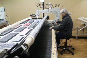 Jane was able to sit down while quilting on a stand up longarm quilting machine at Quilted Joy's longarm quilting machine rental program