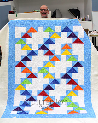 Bill's Flying Geese quilt that he quilted at Quilted Joy