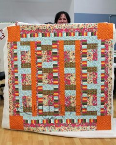 Danielle's Bright and Playful Quilt after her Longarm Quilting Machine Rental
