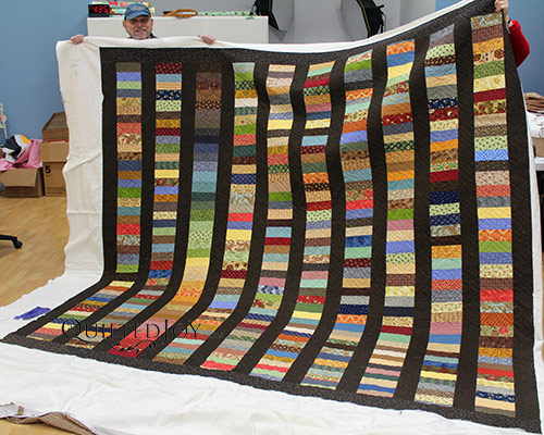 Dennis's stash busting wedding quilt after his longarm machine rental at Quilted Joy