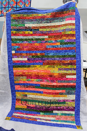 Sally's Batik Jelly Roll Race Quilt after her longarm machine rental at Quilted Joy