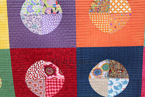 Terry's Circles quilt after longarm machine rental at Quilted Joy