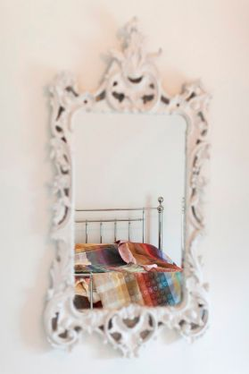 Folklore Fabrics reflected in mirror