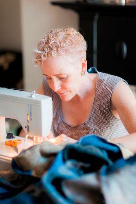Lisa stitching a bespoke Harris Tweed super king size quilt