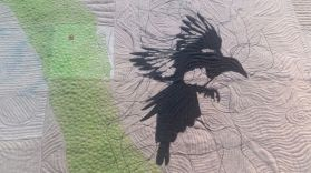 Embroidered magpie - detail of a winning quilt.