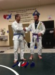 Greg Martinez getting his blue belt on 3/12/13.