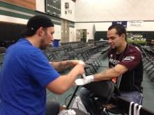 Jimmy Thompson of T-Town MMA taping up Edson Penado of the Narrows Fight Team & Quincy Brazilian Jiu-Jitsu for the KOA Combat fight