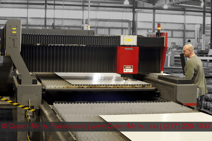 One of two lasers, Quincy Metal Fabricators' Cincinnati CL440 Laser cutting 20 gauge steel at 800 ipm