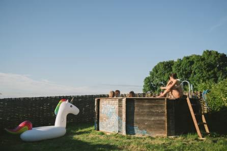 enjoying pool at quirky camping