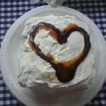 Make your own ice cream cake using ice cream sandwiches, chocolate sauce, caramel and cool whip for an easy, delicious treat | Ice Cream Sandwich Cake