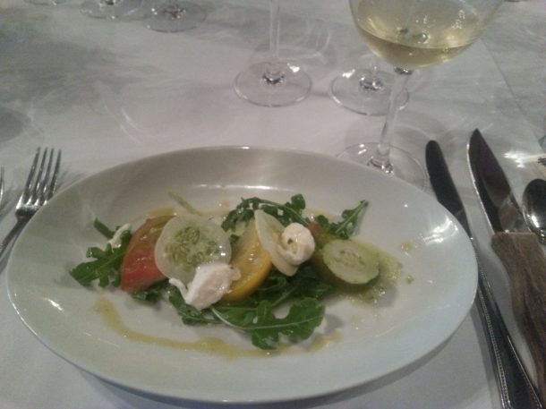 Heirloom tomato and cucumber salad with arugula, burrata and basil vinaigrette