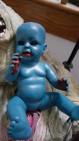 I ran out of white paint to make this doll more grey/blue...and he turned into a creepy blue zombie baby