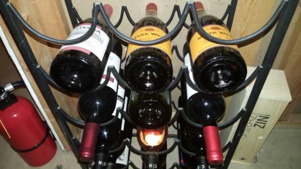Store sloped shoulder wine bottled backwards