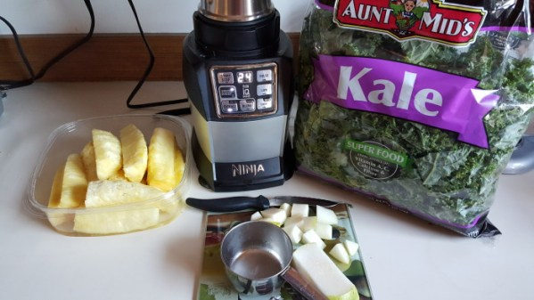 I made a Kale Smoothie with my Nutri Ninja using kale, pineapple slices, and pears.