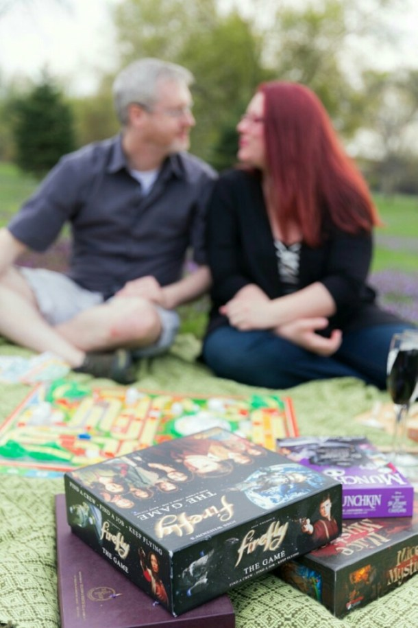 adorable engagement photo with board games and a picnic