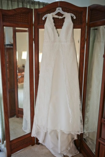 I love this wood tri-fold standing mirror in my bedroom. It was the perfect spot to hang my wedding gown.