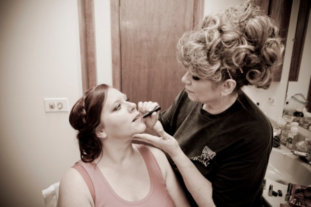 my aunt putting on my bridal make-up the day of my wedding.