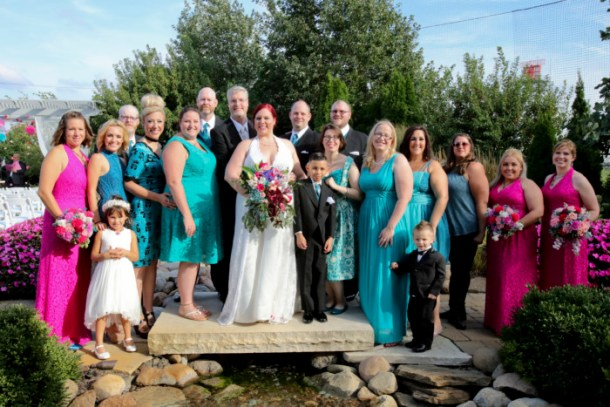the full bridal party with bride, groom, groomsman, bridesmaids, ushers/bridesmen, something blue crew, flower girl, and ring bearer.