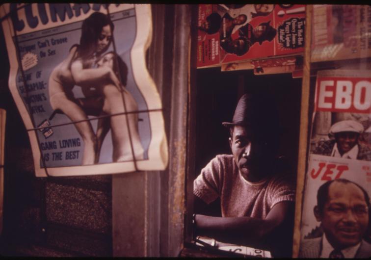 Black Man Operating A Newsstand