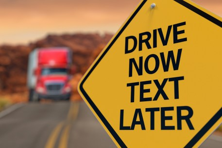 Free texting and distracted driving images containing keyword sign