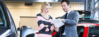 A car dealer with a customer