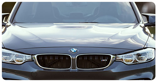 Car Insurance represented by the front of a BMW