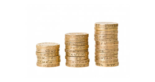 SME Business Insurance represented by a stack of British Pound Coins