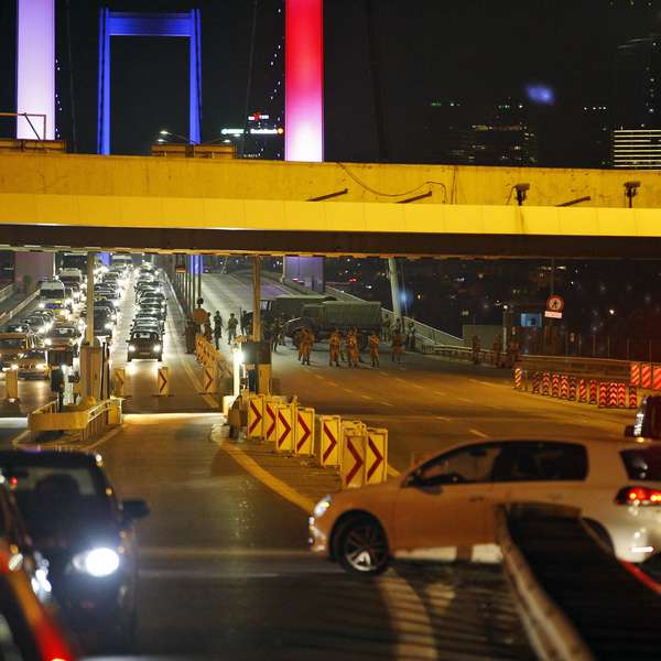 "Turkish soldiers block the Istanbul's iconic Bosporus Bridge, lit in the colours of the French flag in solidarity with the victims of Thursday's attack in Nice, France, Friday, July 15, 2016. Turkey's prime minister says a group within Turkey's military has engaged in what appeared to be an attempted coup. Binali Yildirim told NTV television: ""it is correct that there was an attempt."" (AP Photo/Emrah Gurel)"