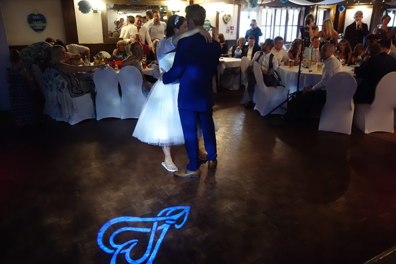 Wedding DJ playing the first dance for the newly weds with love heart lighting at Seiners Arms, Perranporth