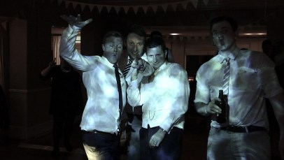 Silly faces and drunken antics by the groom and friends in Padstow, Cornwall