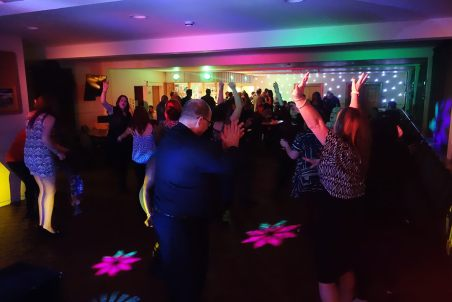 Everybody letting their hair down at ASDA's Christmas Party in Hayle, December 2015