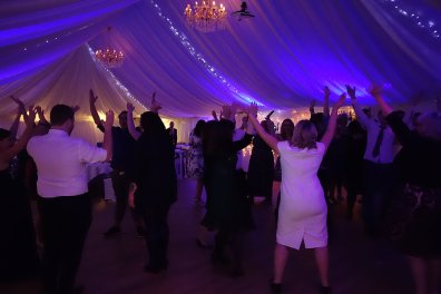 Guests dancing, all with hands in the air, Gwel an Mor, Nov 2015