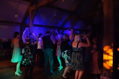 Packed Dancefloor lit by blue and green washes at Nicola & Oliver's Wedding, Nancarrow Farm, September 2015