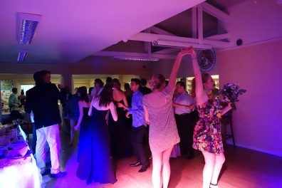 Two ladies dancing in the spotlight at Aby & Moya's Wedding, Penryn Rugby Club, August 2015