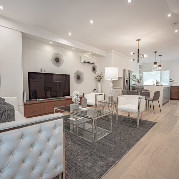 Interior of an open concept, modern home staged by R3 Home Staging