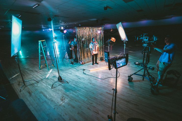 A full studio setup in the middle of a dance floor, showing us what's behind the curtain of this company's marketing and production