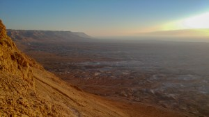 Sunrise over valley, cliff face to side