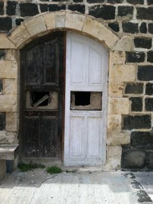 Old doors of an early Jewish settlement near the Jordanian border