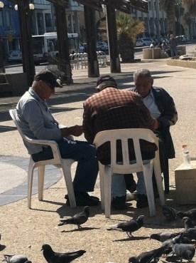 "Old men playing ""sheshbesh"" (backgammon) on the beach in Tel Aviv"