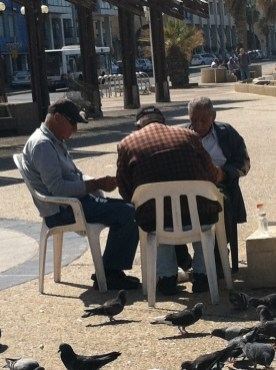 "Old men playing ""sheshbesh"" (backgammon) on the beach in Tel Aviv"