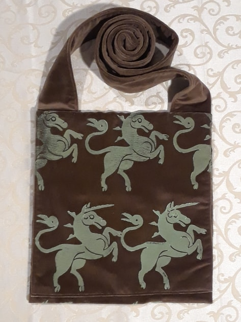 Bag made from brown handprinted velvet, printed with hand carved unicorn stamp.