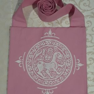 Bag made from pink cotton canvas, lined, printed with a hand carved 11th century middle eastern lioness stamp.
